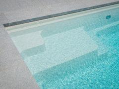 Welke afwerkingsmogelijkheden zijn er voor mijn zwembad?